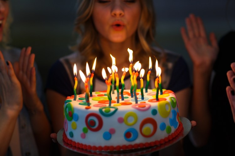 cake while blowing candles