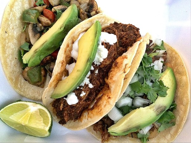 Tacos - Soft corn tortillas filled with beef, veggies and chorizo