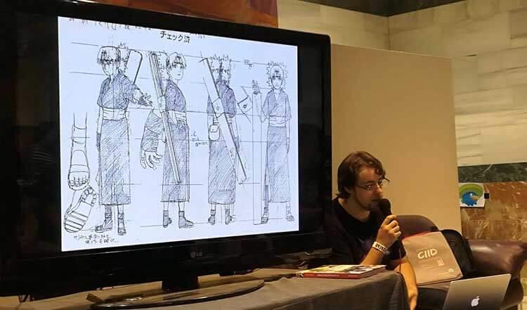Antonio Horno explicando fundamentos de anime a unos asistentes a una de sus conferencias.