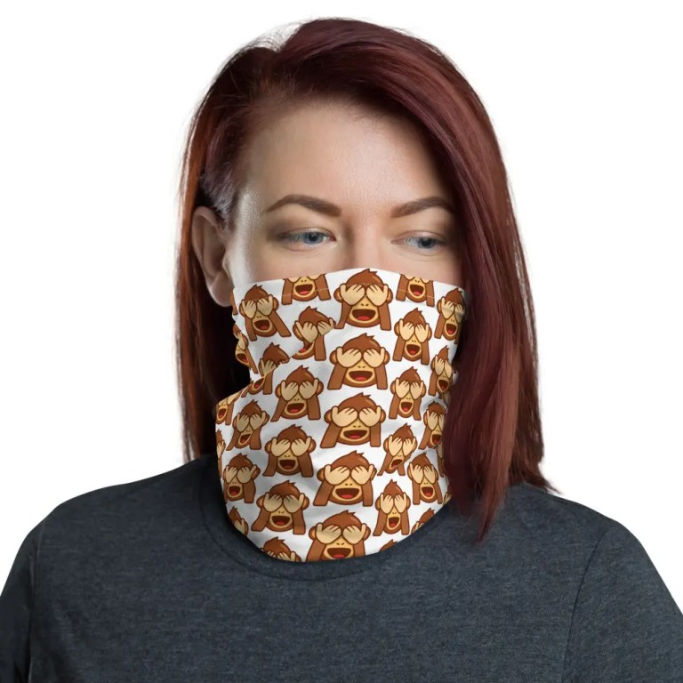Woman wearing face gaiter with monkey design.