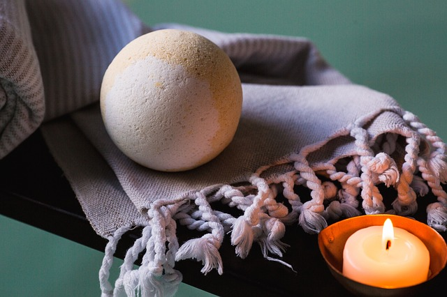bath bomb on towel with candle