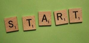 scrabble tiles spelling start