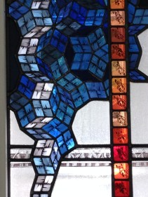 "Detail of ""Mathematicians"" a stained glass portrait of Sir Roger Penrose and student with Superman by Debora Coombs"
