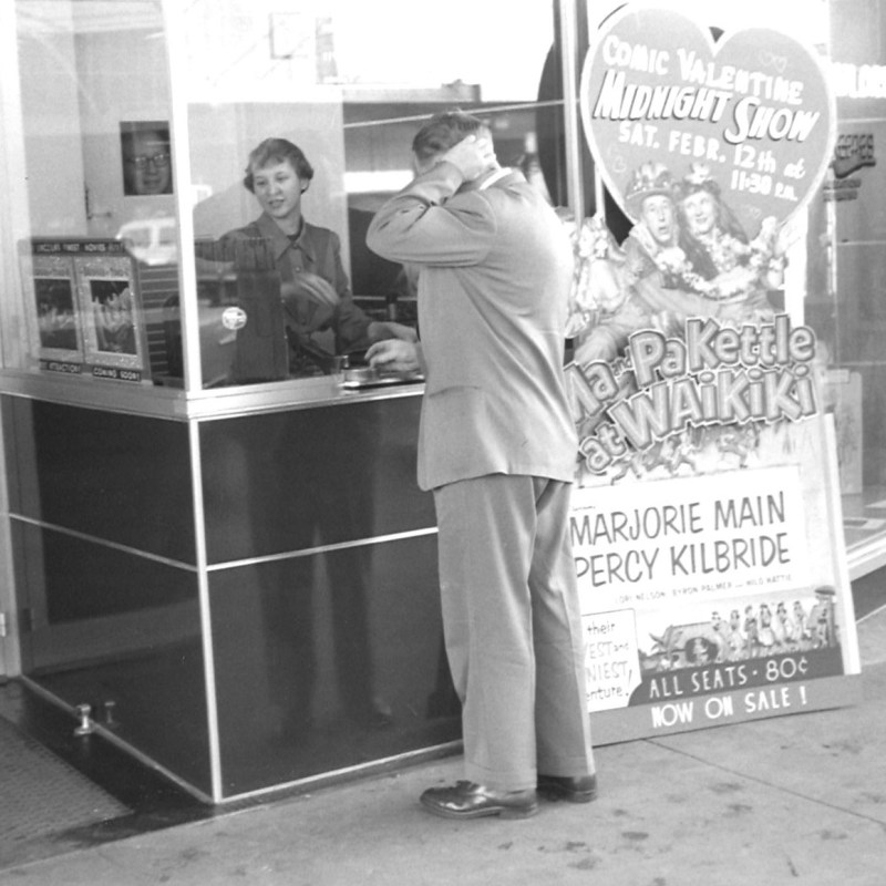 "Lincoln Theatre, Lincoln, NE, Spring 1955. Ticket window, ""Ma and Pa Kettle at Waikiki"" standee."