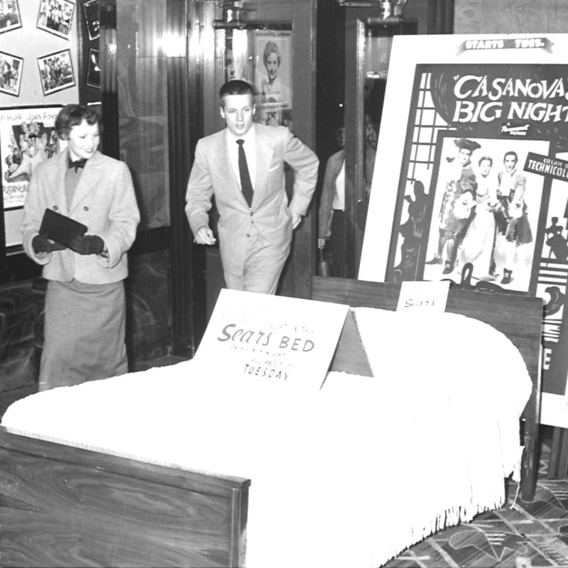 "Lincoln Theatre, Lincoln, NE, Summer 1954. Theatre lobby, ""Casanova's Big Night"" promotional display."