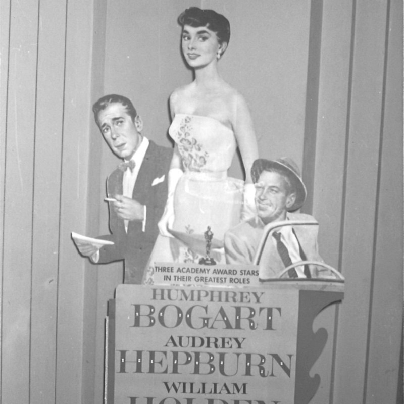 "Lincoln Theatre, Lincoln, NE, Fall 1954. Theatre lobby, ""Sabrina"" standee with Humphrey Bogart, Audrey Hepburn, and William Holden."