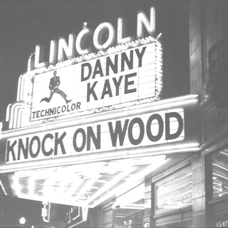 "Lincoln Theatre, Lincoln, NE, Fall 1954. Theatre marquee featuring Danny Kaye in ""Knock on Wood."""