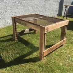reclaimed wood garden table with wire mess top
