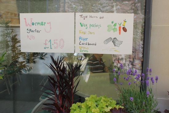 sings on a window advertising wormery starter kits