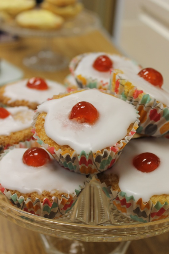 small cakes with icing and a cheery on top