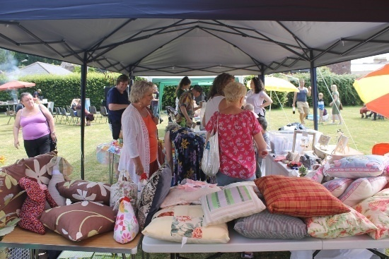 people pour over the crafts of cushions, fabrics and more at the Co-ordin8 Phoenix Craft Stall