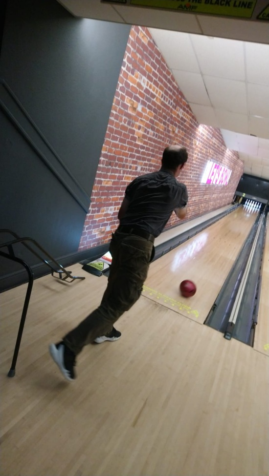 a man is ten pin bowling