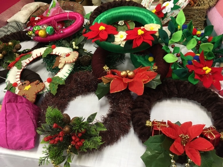 a selection of Christmas wreaths on a table