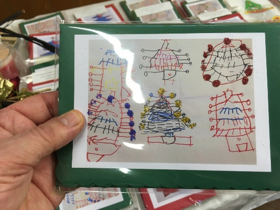 a co-ordin8 Christmas card with drawings of six Christmas cards