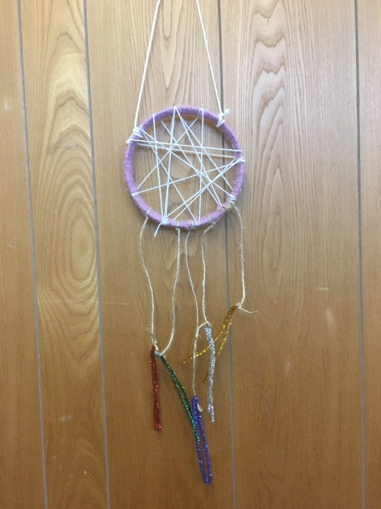 a dream catcher - a round circles with woven edges