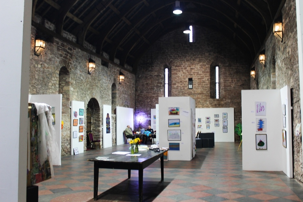 the inside of the Spanish Barn Torquay, with the exhibition panels up and art on them