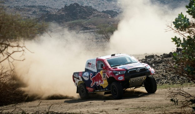 A pickup truck competes in the Dakar Rally, one of the most grueling off-road races in the world.