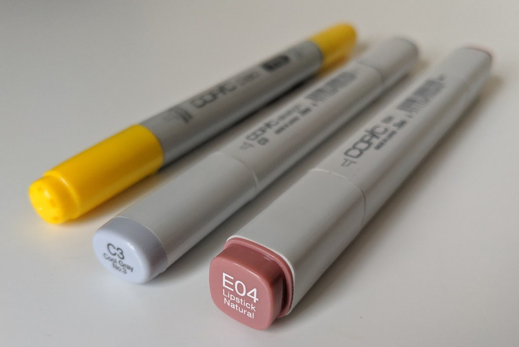 A photograph of a Copic Ciao, a copic Sketch and a Copic Classic.