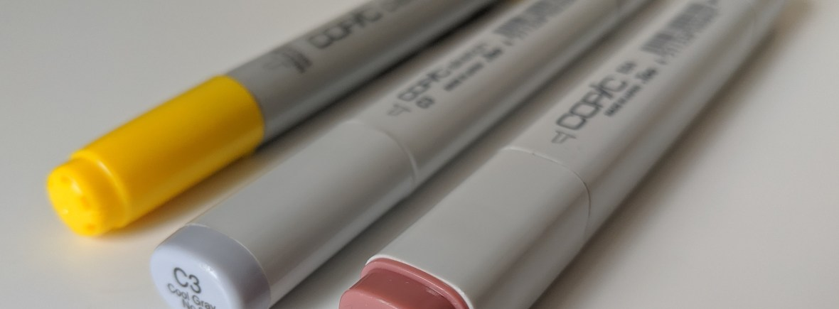 A photograph of three different kinds of copic markers