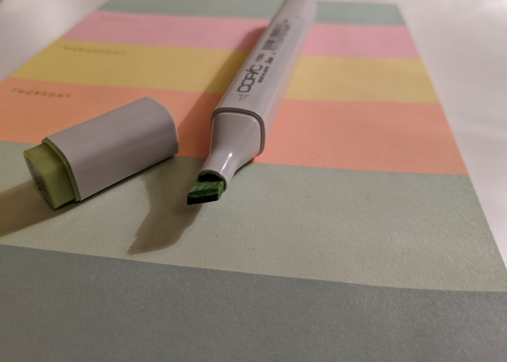 Copic classic with lid off on colourful note pad