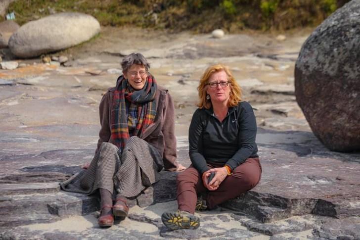 Bhutan Jeanne and CH on rocks 56947202_10215835899024646_3034848248113135616_n - Copy (2)