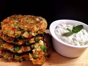 The finished fritters served with the cooling mint and yoghurt dip