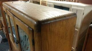 This is a close up of the top front corner joint. Other cabinets may have similar construction.