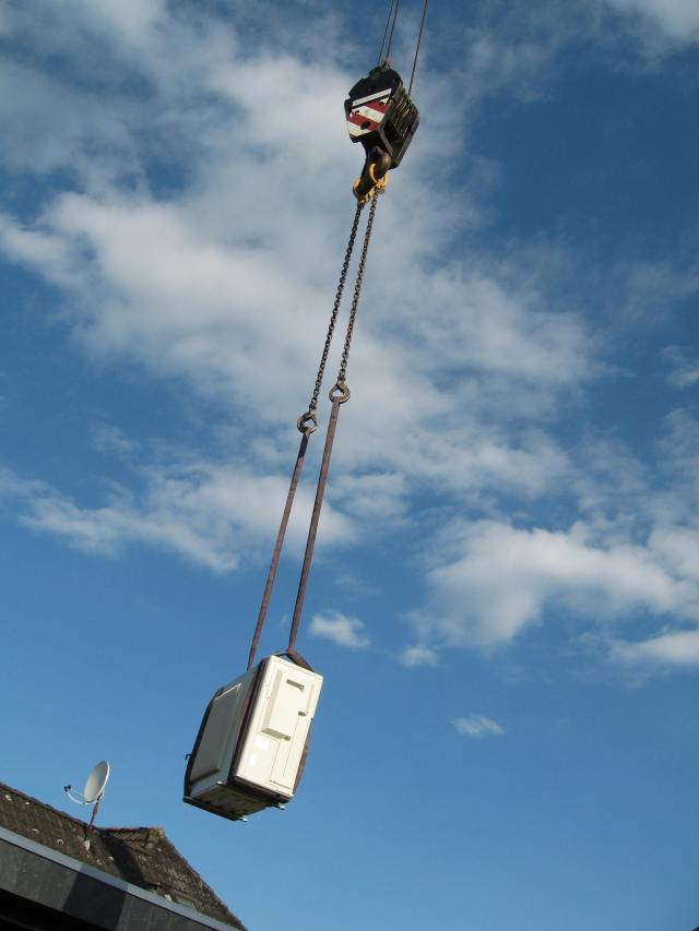 Condenser unit on crane
