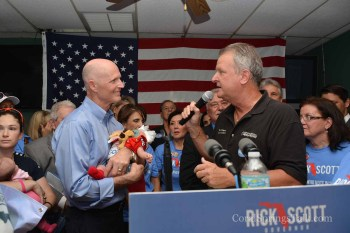 Rick Scott and Tom Powers in Coral Springs