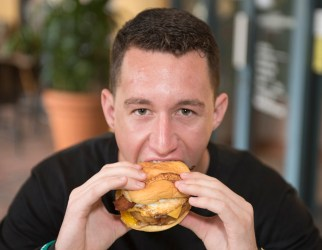 Coral Springs Charter School Senior Greg Ohl enjoying his Breakfast All Day Burger from Burger Fi