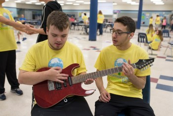 Aaron Sager works with rock star Ben on the guitar