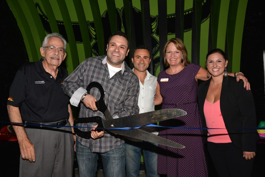 Coral Springs Commissioner Lou Cimaglia; The Feisty Bull Owner, Luigi Carvelli; DaVinci's of Marco Operations Manager Adamo Carvelli; Coral Springs Commissioner Joy Carter; The Feisty Bull General Manager Bianca Perez cut ribbon during grand opening festivities