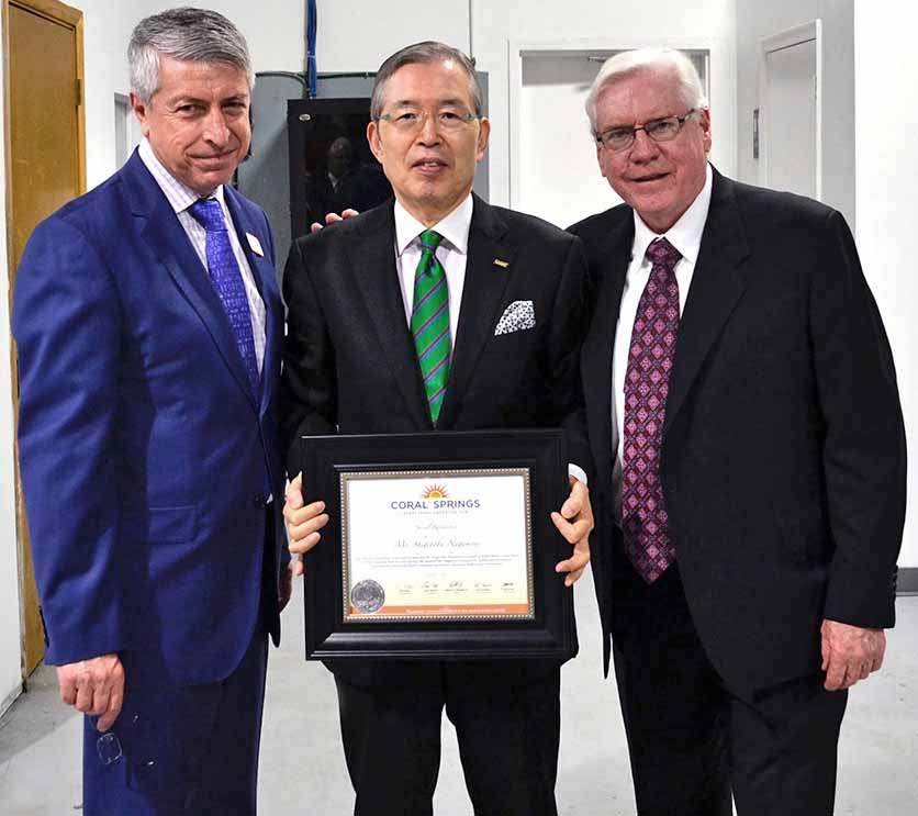 City Manager Erdal Donmez, Mr. Shigenobu Nagamori, Founder and CEO of Nidec Motor Corporation, and Mayor Skip Campbell welcomes Nidec to Coral Springs