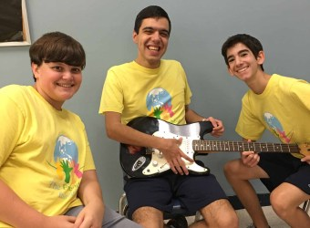 Matthew Velazquez is in the center and volunteers Jamie is and Reece are to the left and right.