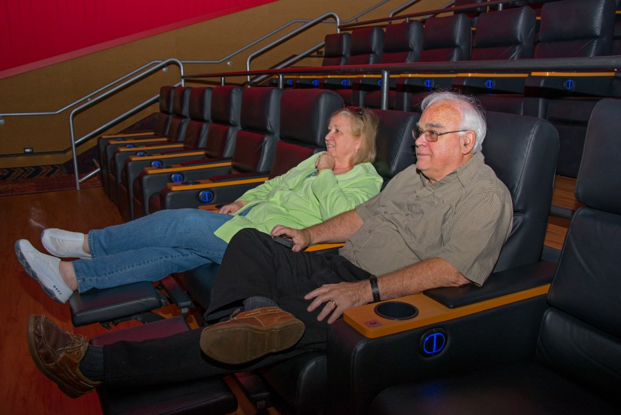Coral Springs, FL residents Sharon and Ward Bennett enjoying the new leather recliners before a matinee at the Regal Magnolia Theater. - Photos by Sharon Aron Baron