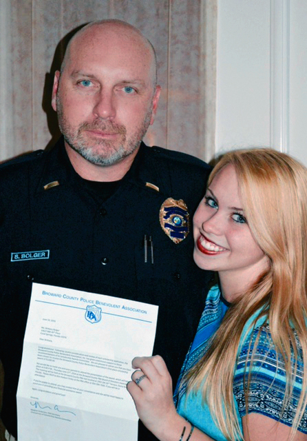 Brittany and her father Lieutenant Steven Bolger of the Hollywood Police Department holding her congratulatory letter.