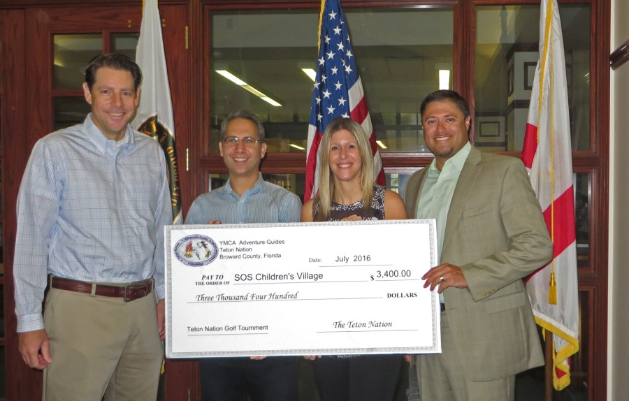 From left to right: Todd Clarke, Adam Miller, Jillian Smath, Executive Director of SOS and  Jackson Self