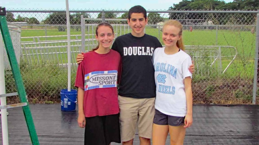 Carson Abt, Cyril Yared, and Annika Mursten DECA Chair Members to Marjory's Garden.
