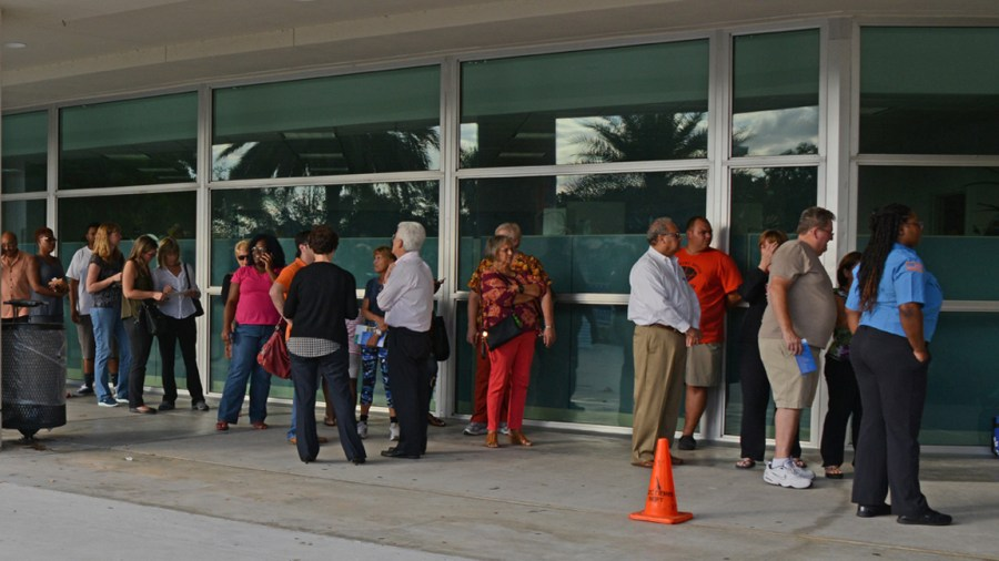 Voters lining up for early voting at the Northwest Regional Library in Coral Springs.