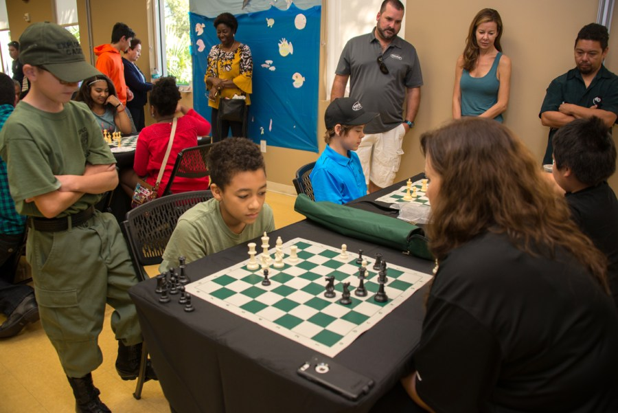 A young challenger plays against Parkland Mayor Christine Hunschofsky at the Mayor's Chess Challenge.