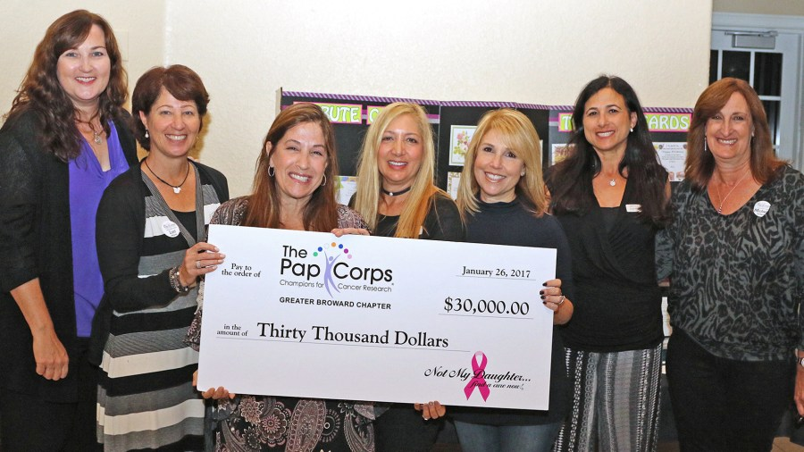 Check presentation.  Left to Right: Parkland Mayor Christine Hunschofsky; Lori Margolis, President Greater Broward Chapter, The Pap Corps.; Jody Sternfield, Debi Weisman, Denyse Hostig, Betsy Fletcher from Not My Daughter; and Michele McMahon, Executive V.P., Greater Broward Chapter, The Pap Corps.