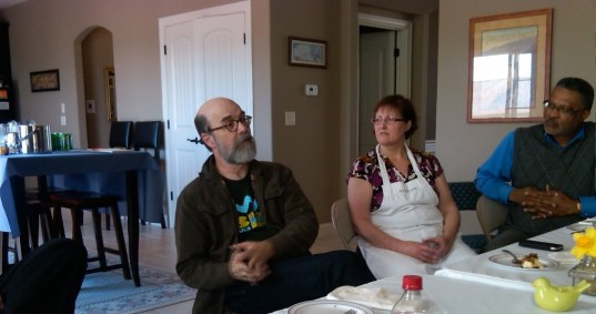 Michael teaches on the Gospel of Matthew as Diane and Don listen intently at the Pastor's Lunch on April 25.