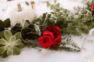Bright Florals, Greenery, and White Pumpkins Run Across King's Table