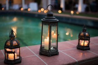 Lanterns and Candlelight Adorn the Pool's Edge