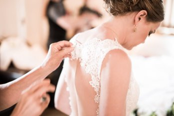 Final Touches on the Bride's Wedding Dress