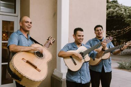 Trio Los Amigos Play Lively Music During Cocktail Hour