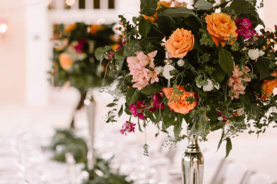 Bright Floral Arrangements in Classic Silver Candelabras Make for Standout Centerpieces