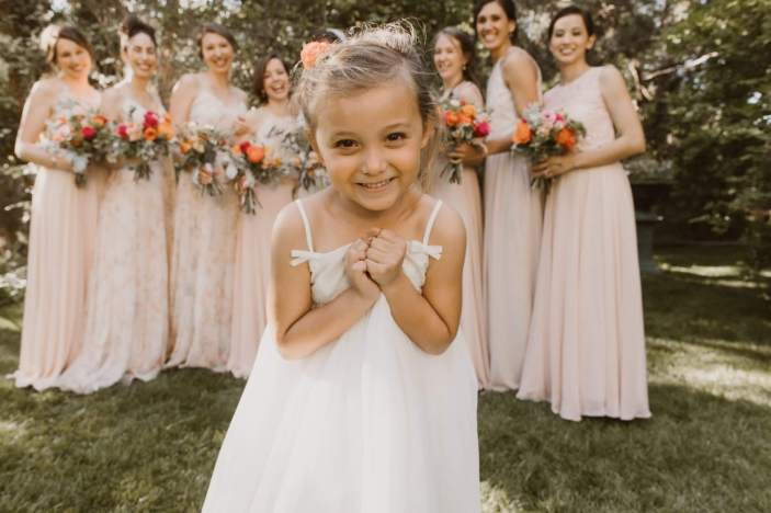 Adorable Flower Girl Is All Smiles Before Walking Down the Aisle