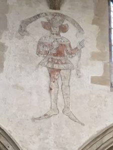 Wallpainting of king, north clerestory, Corby Glen
