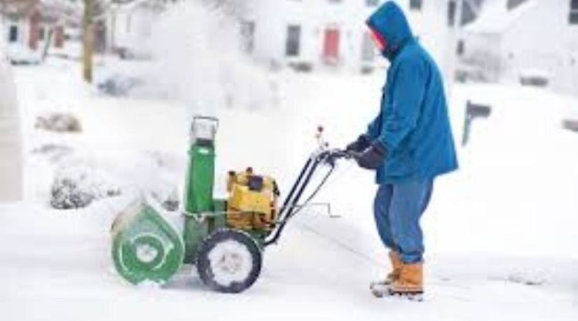 A man using the best cordless snowblower to remove a pile of snow within the home
